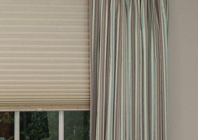 Blackout-honeycomb-shade-under-drapery