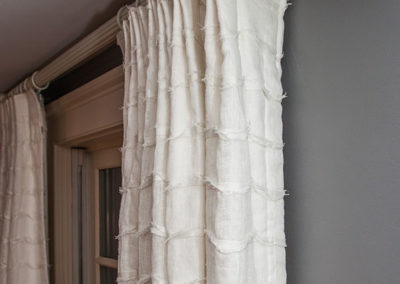 Drapery-on-wood-rod-with-metal-rings