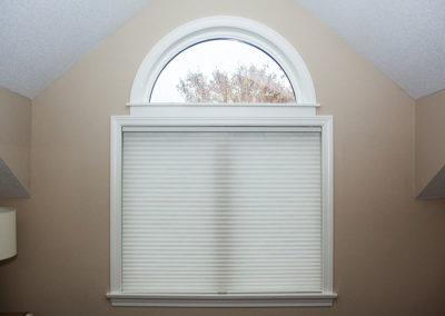 Light-filtering-honeycomb-shade-on-a-double-window