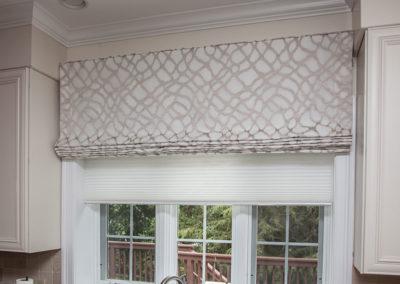 Light-filtering-honeycomb-shade-over-large-vlance